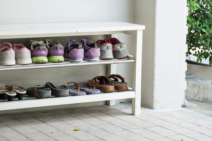 Outdoor Shoe Rack and 8 pairs of visitor shoes; Shutterstock ID 397579045; Job (TFH, TOH, RD, BNB, CWM, CM): TOH Shoe Ban