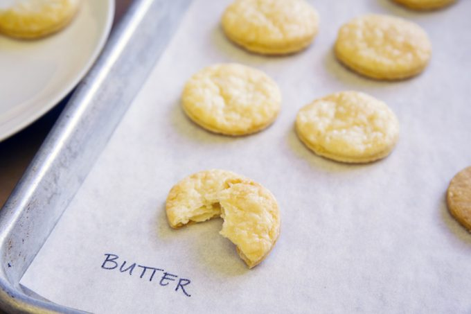"""Pie crust with butter taste test - cookie-shaped pieces shown on a baking sheet labeled with """"butter"""""""