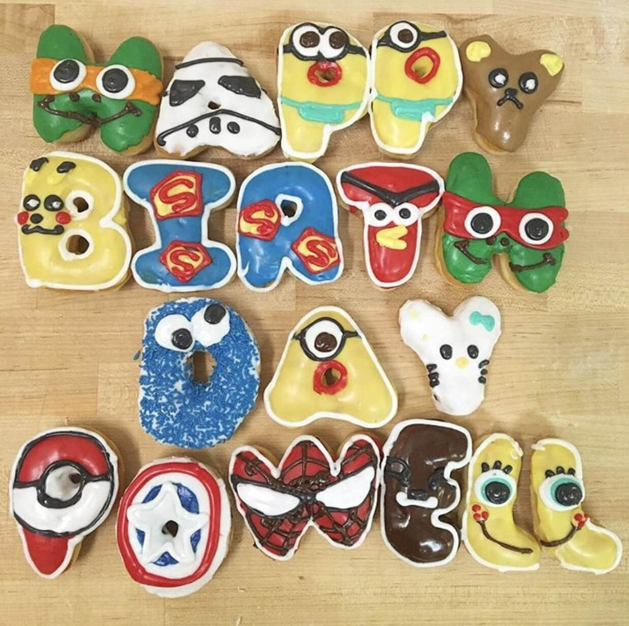 """Donuts together to spell out """"Happy Birthday Powell"""""""