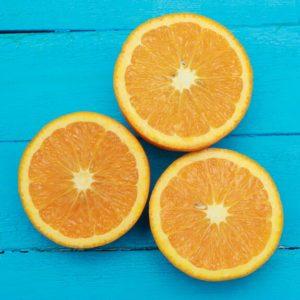 Fresh Oranges On Turquoise Background