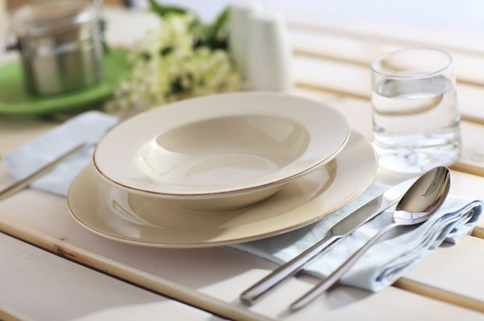 Dinner Place Setting On A Garden Table with Silver Spoon And Knife