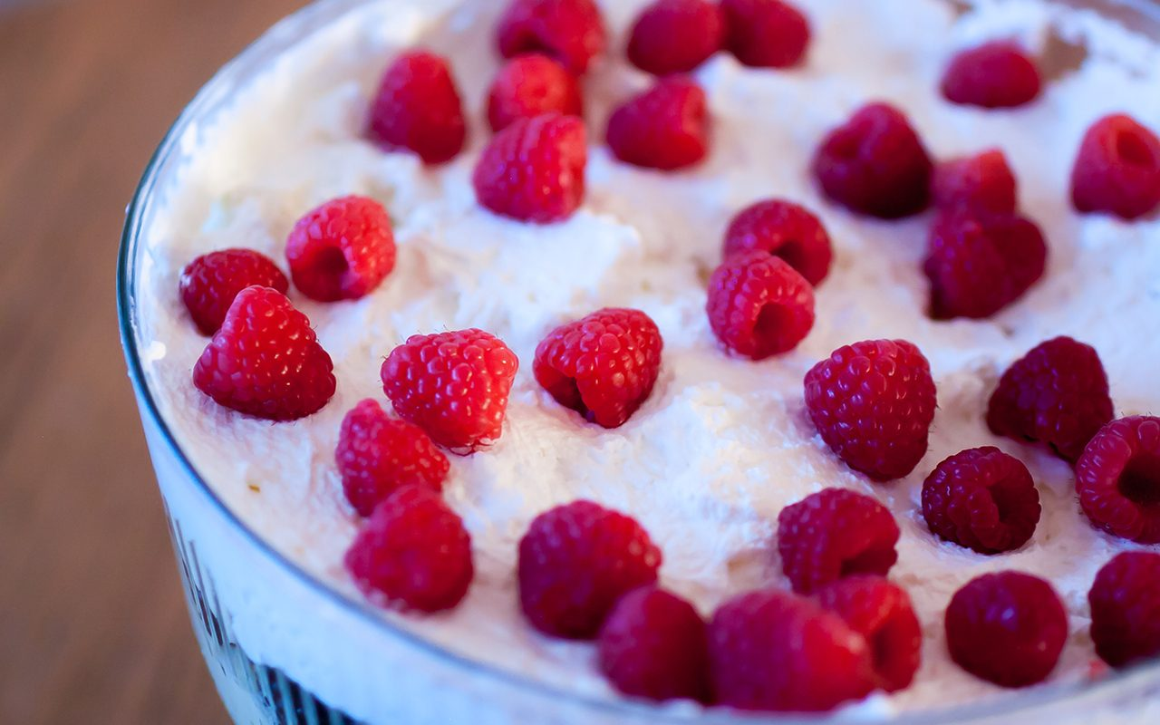 Trifle topped with cream and raspberries - how to make trifle