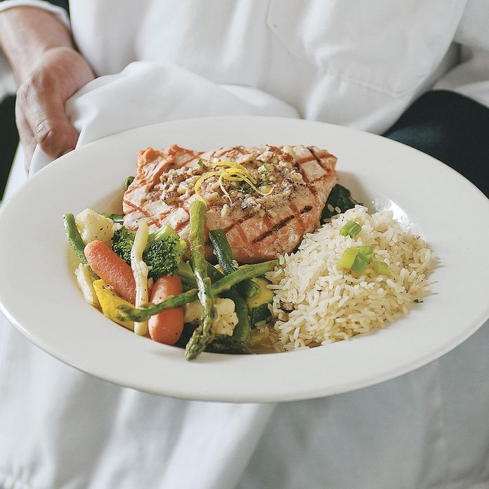 Wild Salmon with Hazelnuts Over Spinach
