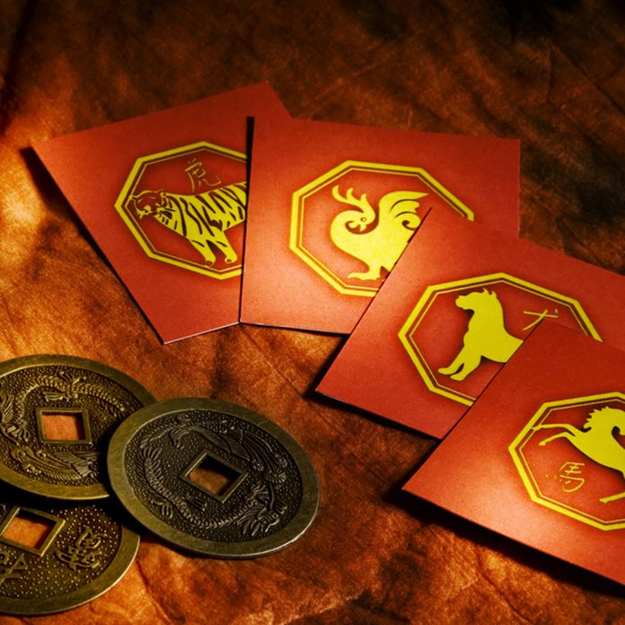 chinese lucky coins, yin yang, iching and horoscope signs cards; Shutterstock ID 20512985