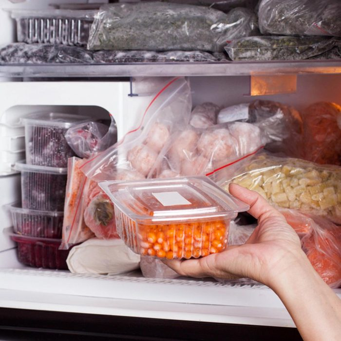 Frozen food in the refrigerator. Vegetables on the freezer shelves.; Shutterstock ID 1013189377