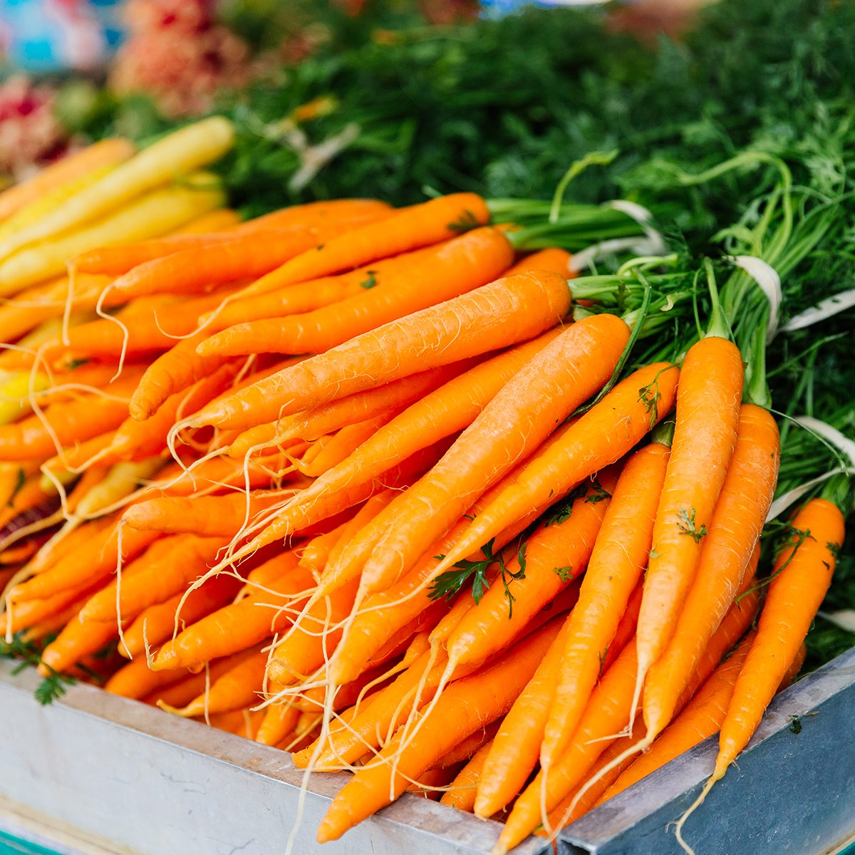 Fresh carrot on the market stall at the farmer's market