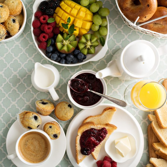 Healthy and unhealthy breakfast food at table