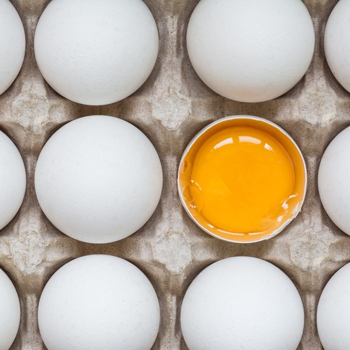 Chicken egg is half broken among other eggs