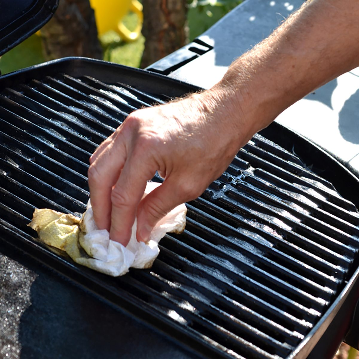 Cleaning the outdoor grill; Shutterstock ID 729824278