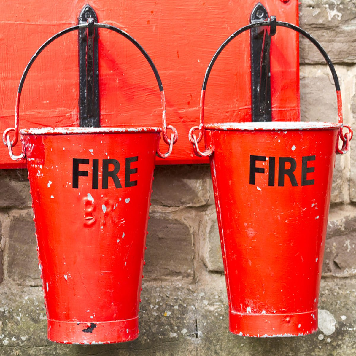 Two slightly battered hanging fire buckets