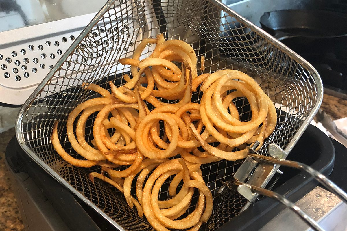 Fries coming out of the fryer