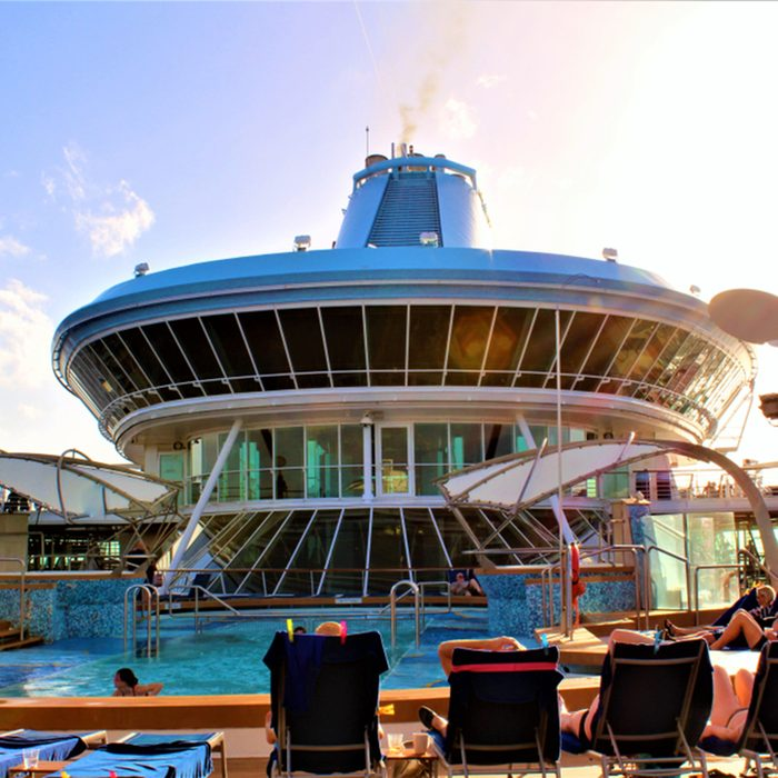 People relaxing on the pool deck of the Marella Discovery cruise ship.