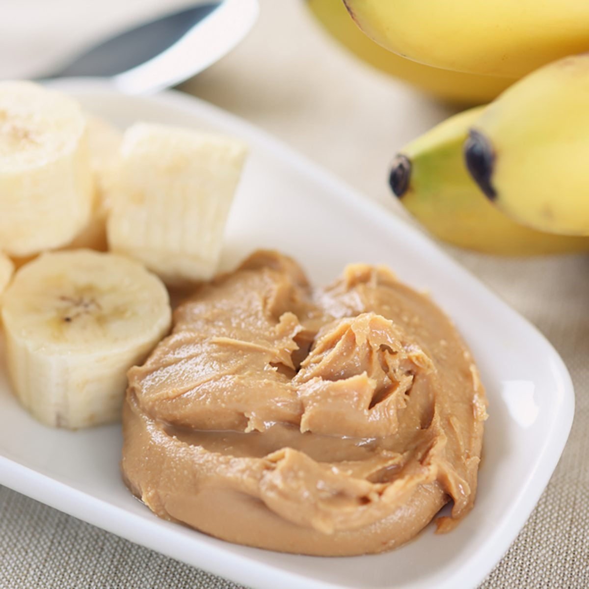 Homemade peanut butter and bananas. Homemade peanut butter ingredients: peanuts (roasted, unsalted, shelled), peanut oil, honey. No salt, no sugar.