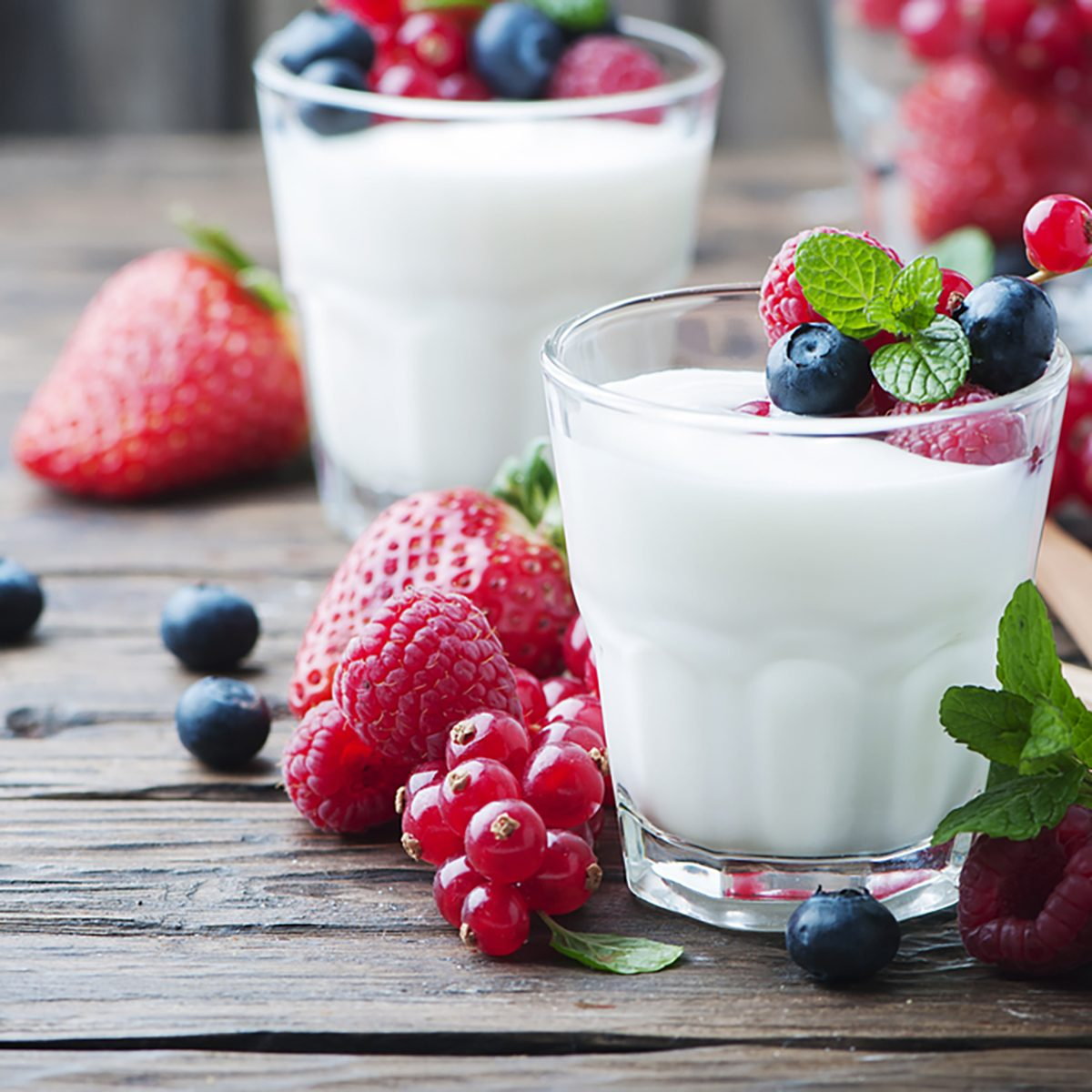 Healthy yogurt with mix of berry, selective focus