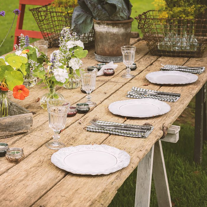 Wooden table setup for garden party or dinner reception.