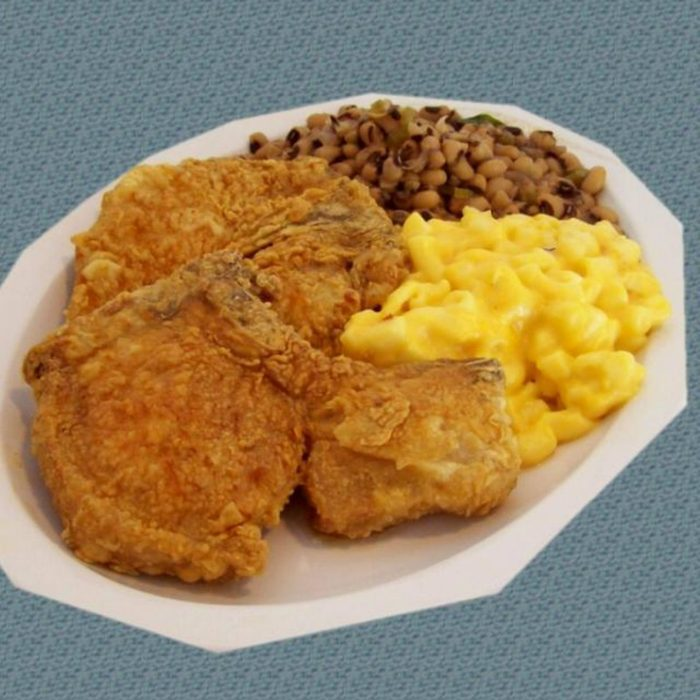 Plate of fried chicken and sides at Mrs. White's Golden Rule Cafe