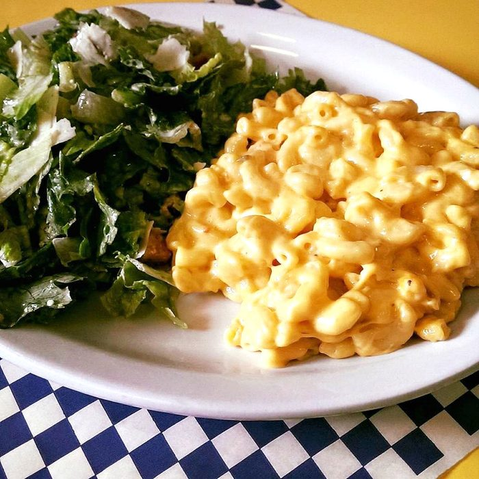 Mac and cheese and greens on a plate