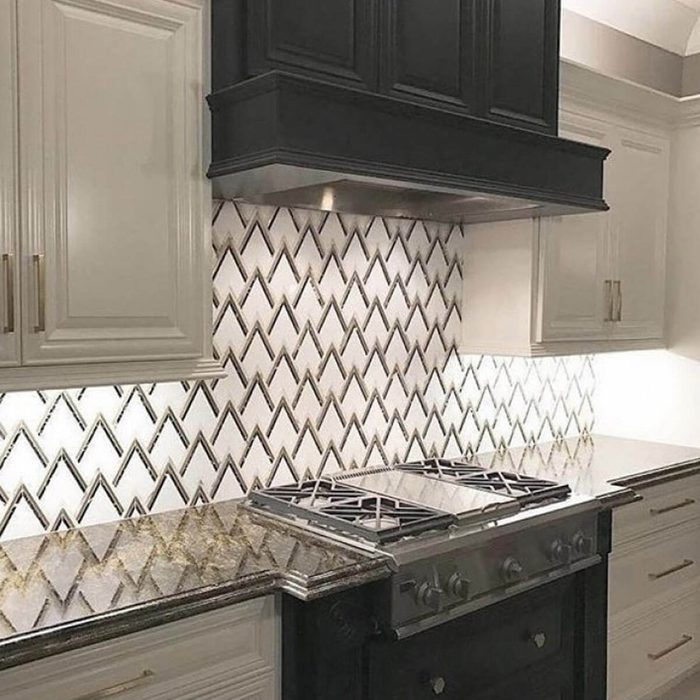 Kitchen with an art deco-style backsplash