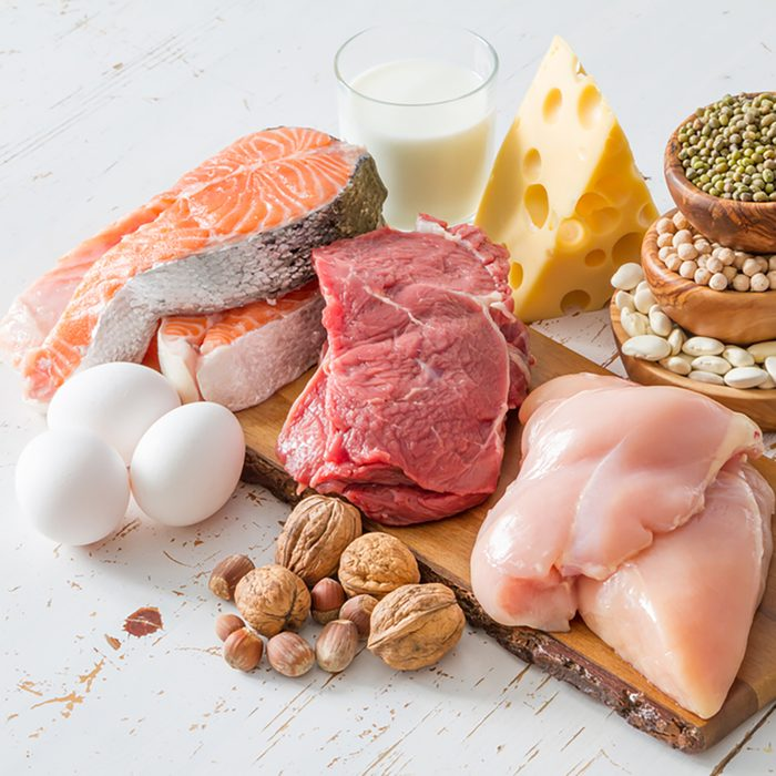 Selection of protein sources in kitchen background,