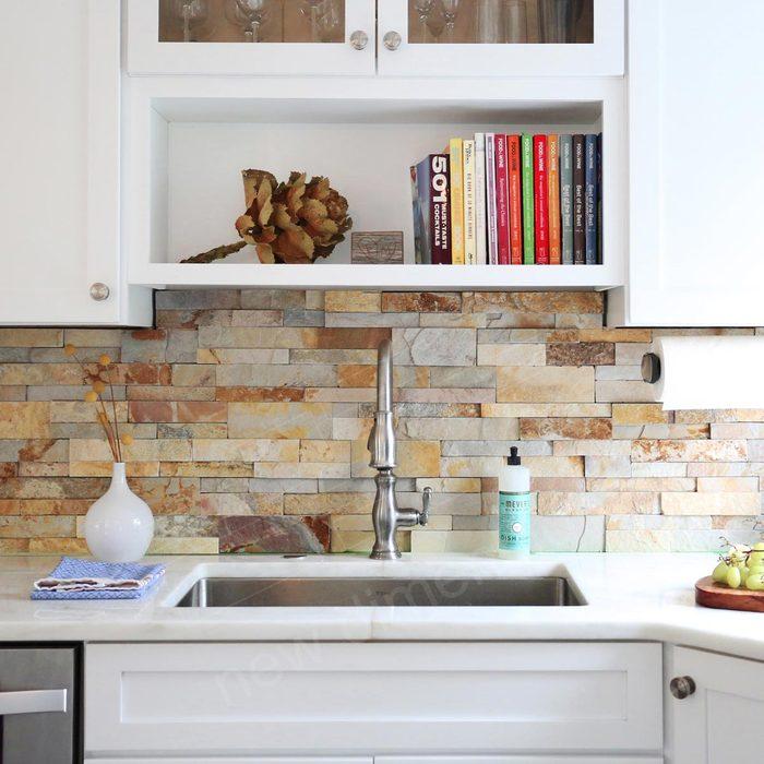 Kitchen with a stone backsplash