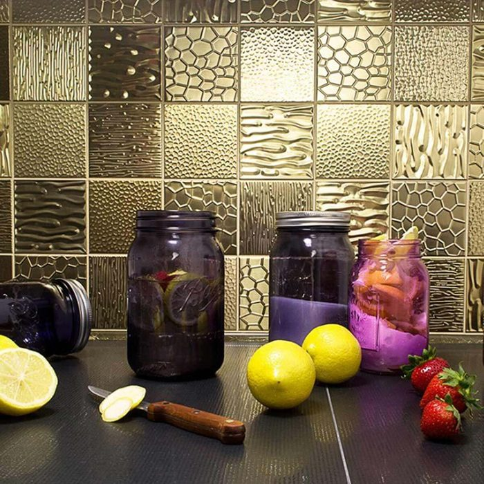Kitchen featuring a metallic backsplash