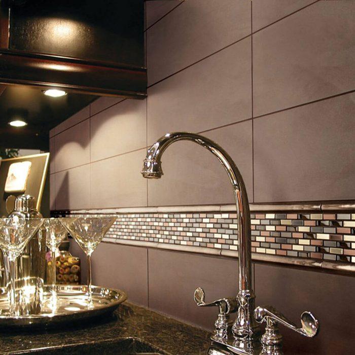 Kitchen with elegant mix and matched tile backsplash