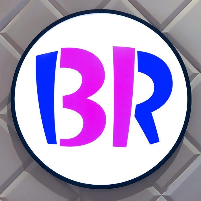 Large Baskin Robbins logo signage on white wall.