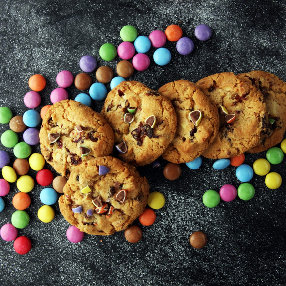 Chocolate cookies with colorful candies.