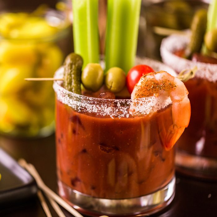 Bloody mary cocktail garnished with celery sticks and olives.; Shutterstock ID 722064856; Job (TFH, TOH, RD, BNB, CWM, CM): Taste of Home