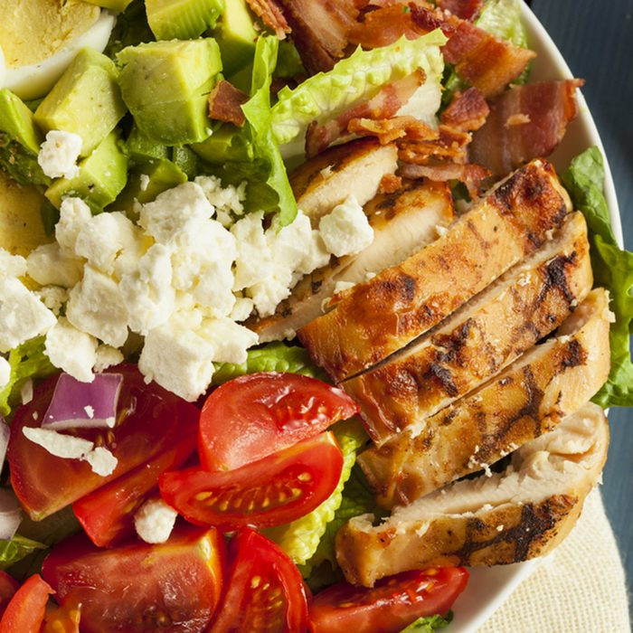 Hearty Cobb Salad with Chicken Bacon Tomato Onions and Eggs