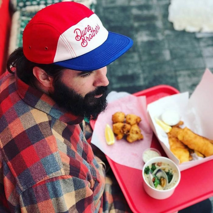 Man eating clam cakes