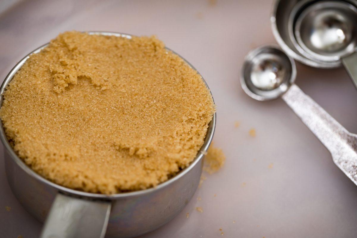 Brown sugar in a measuring cup; Shutterstock ID 1040731477;