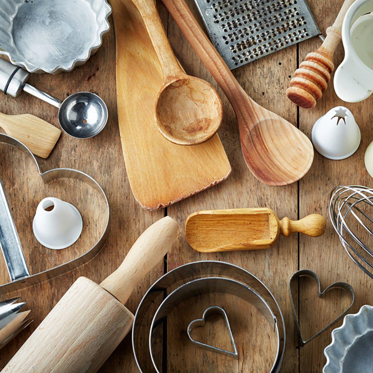 various kitchen utensils on wooden table