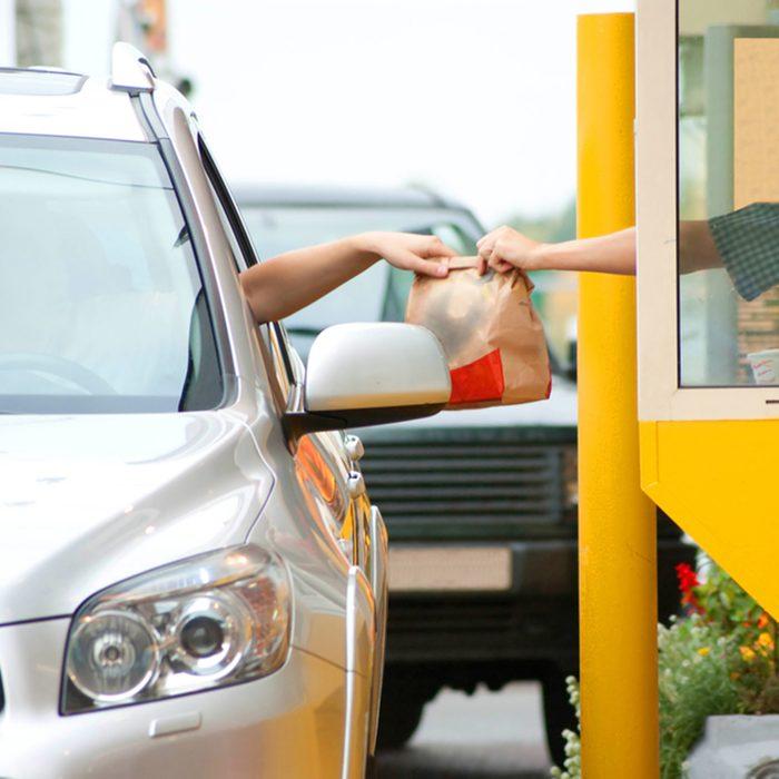 Drive thru fast food restaurant.(motion blur); Shutterstock ID 38753659