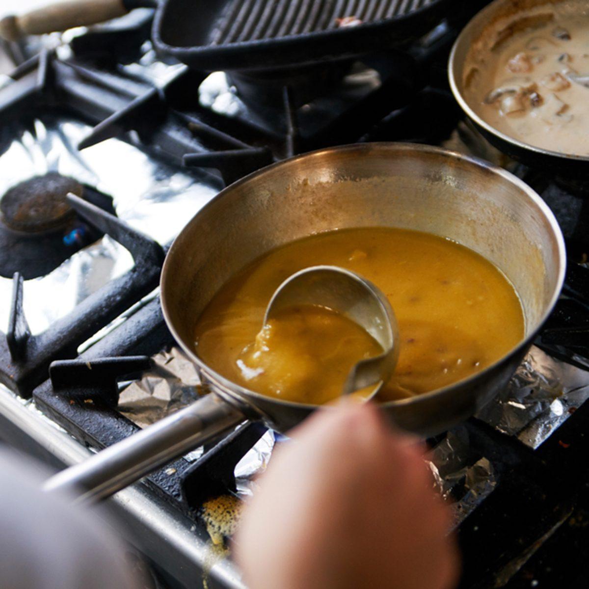 Making Gravy On The Restaurant Stove