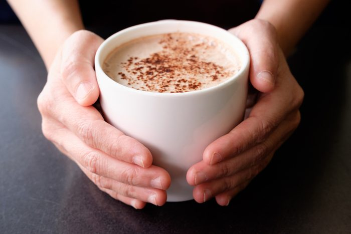 Handle hot cup of chocolate.; Shutterstock ID 575054329; Job (TFH, TOH, RD, BNB, CWM, CM): Taste of Home
