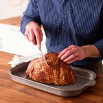 Carving a baked ham