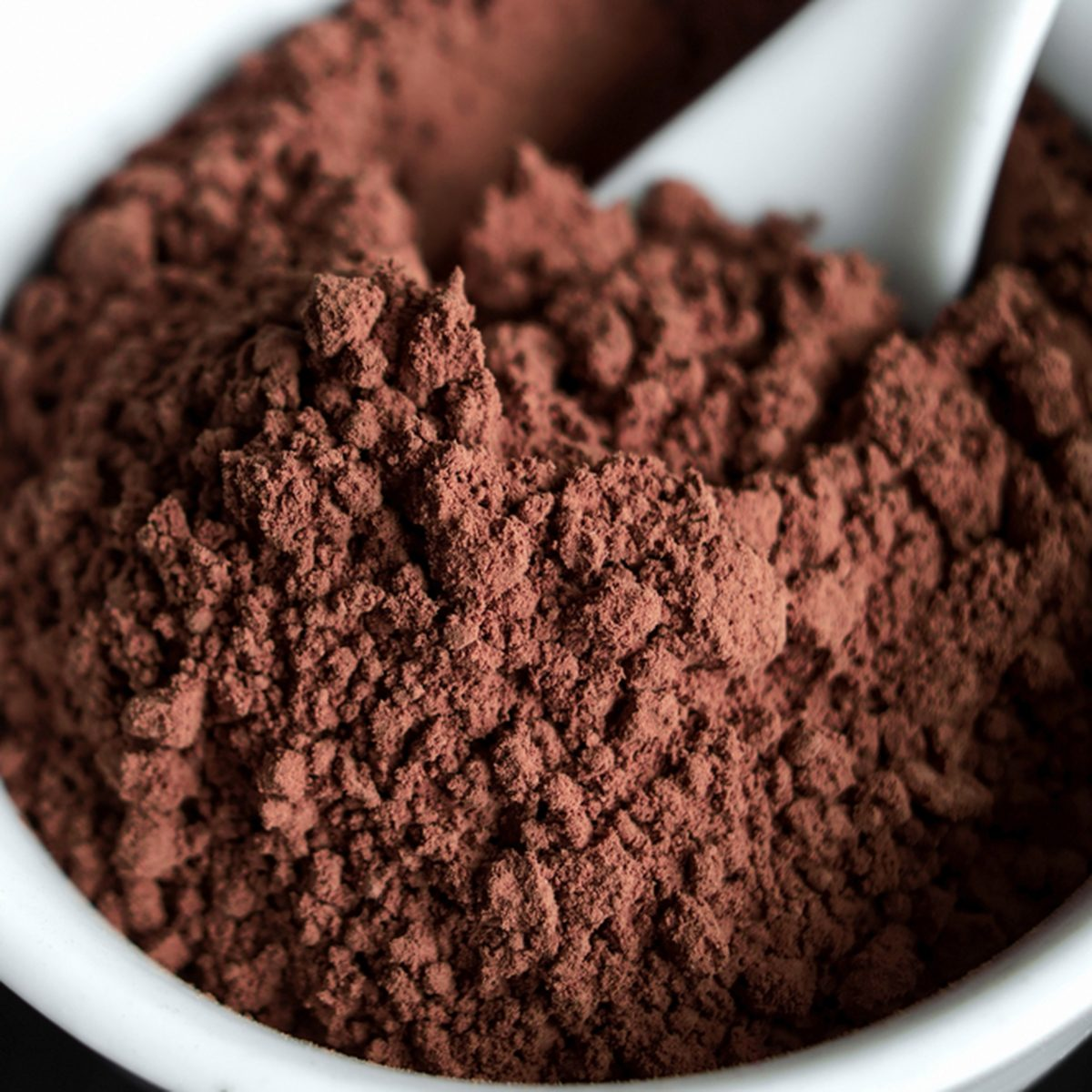 Cocoa powder in a bowl close up