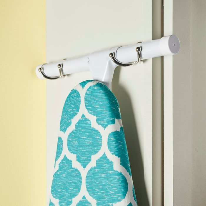 Ironing board coat hook holder