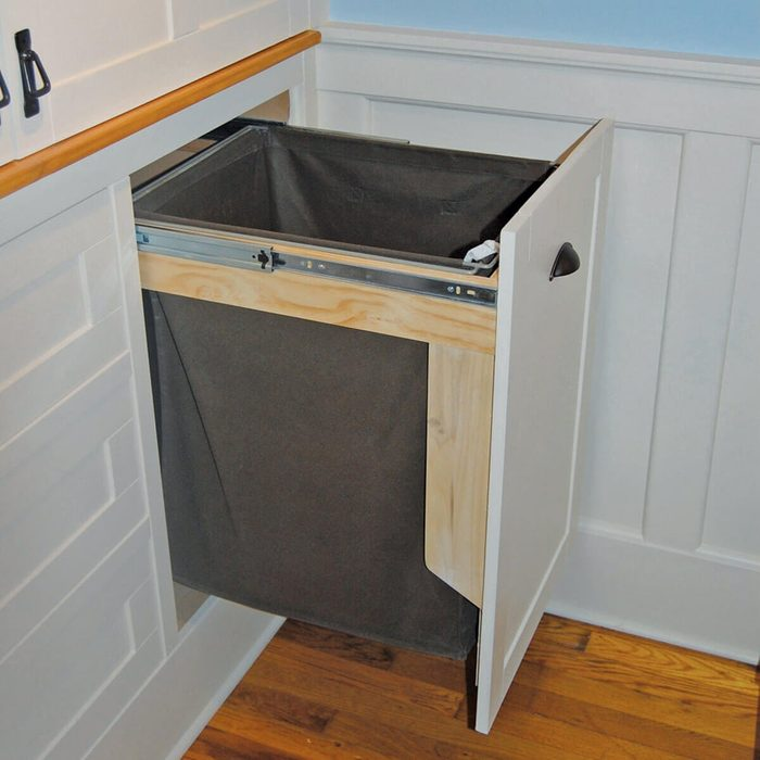 Slide out laundry hamper