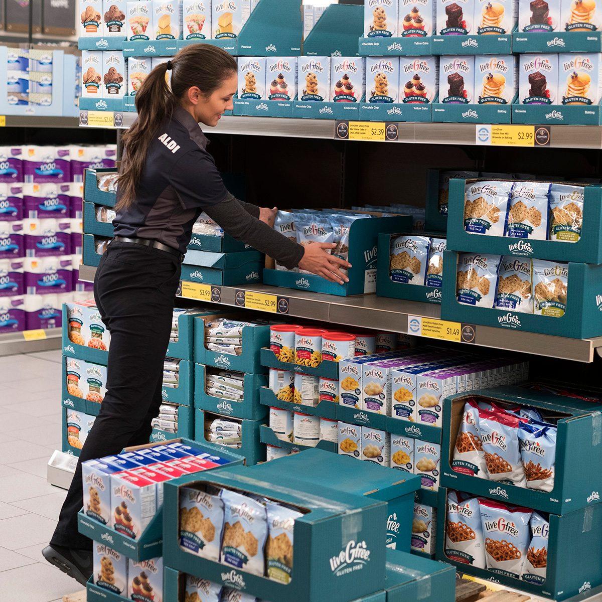 Aldi employee stocking shelves