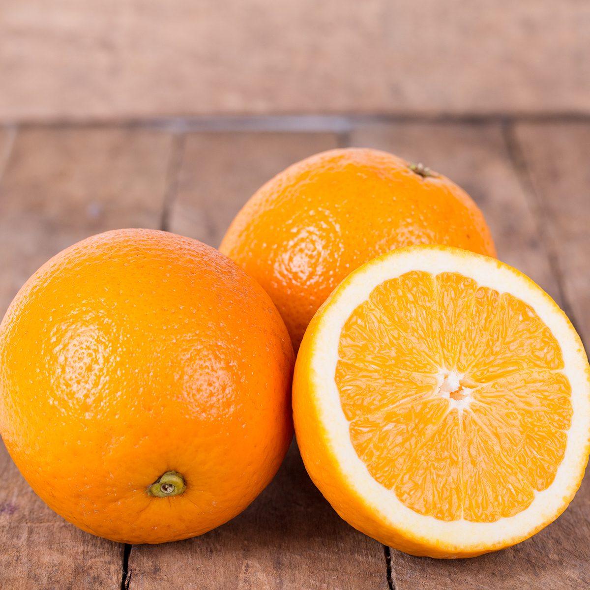 fruits for diabetics fresh, juicy, orange on a wooden background
