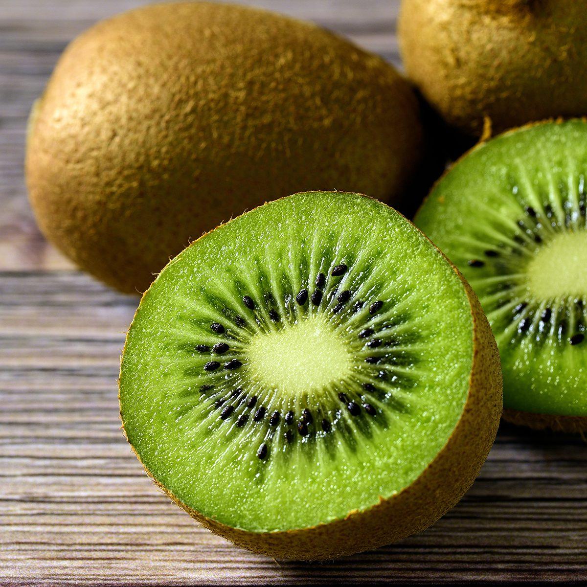 fruits for diabetics Sliced fresh kiwi fruit on wood table