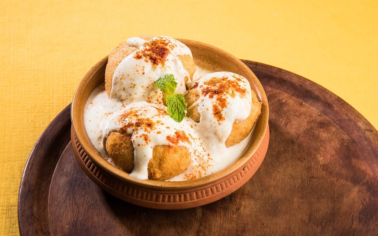 Dahi Vada or Bhalla is a popular snack in India served in a bowl.