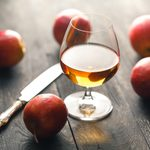 whiskey and apples on dark wooden table; Shutterstock ID 736289938; Job (TFH, TOH, RD, BNB, CWM, CM): TOH