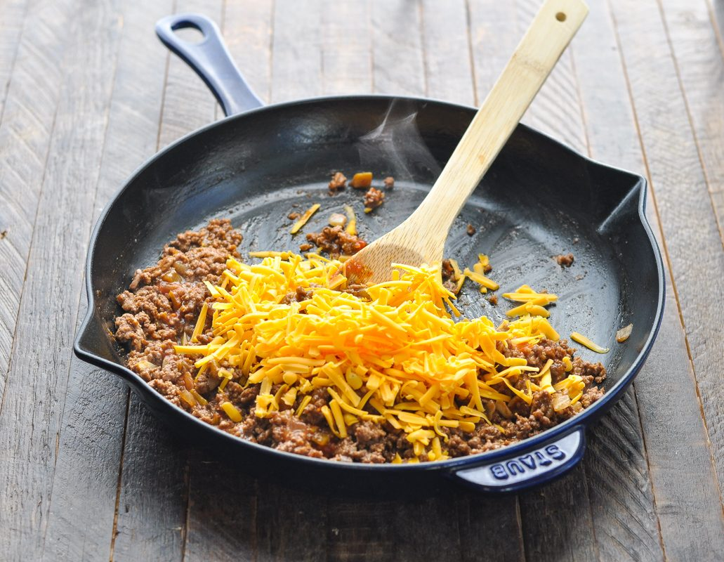 Cheese on top of browned ground beef