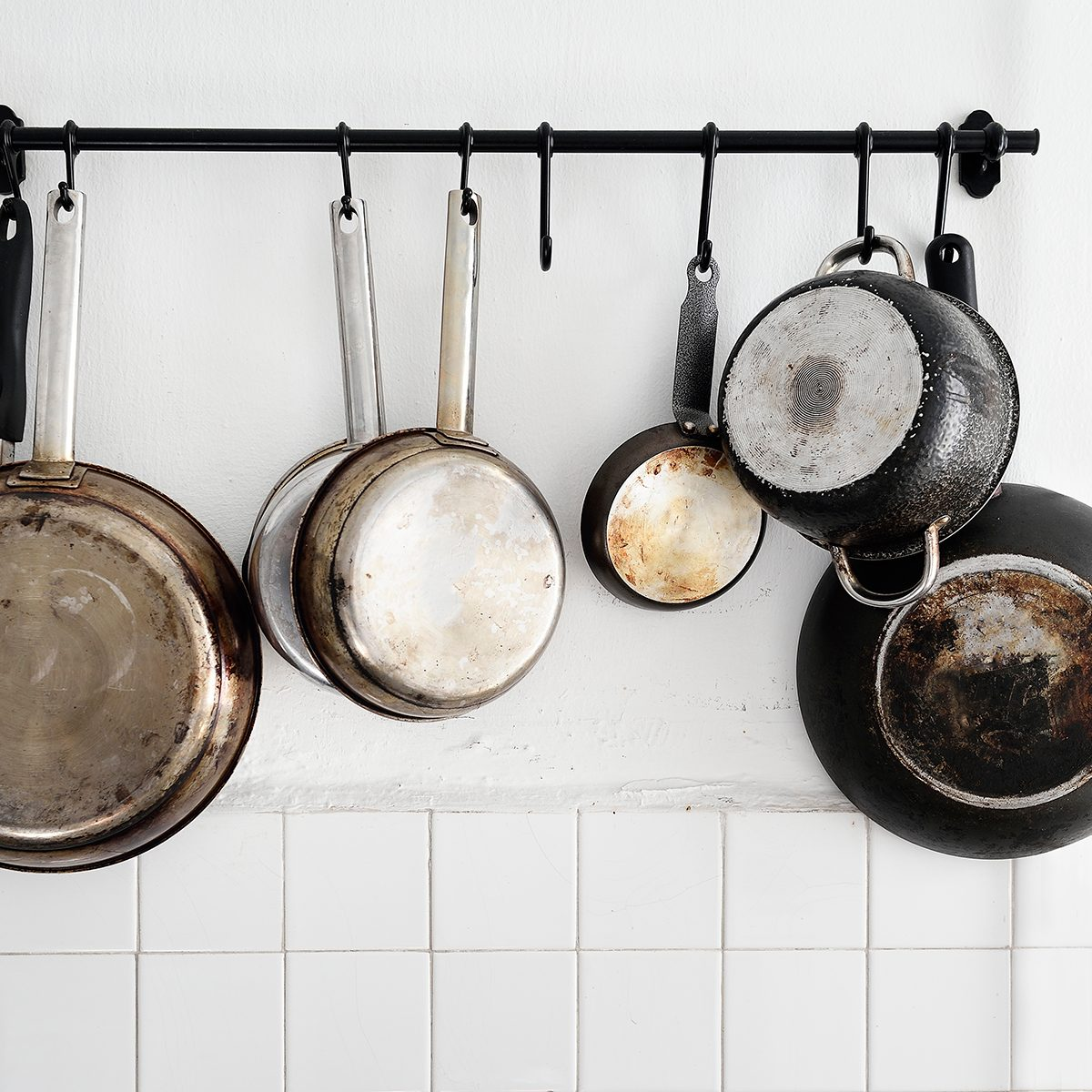 Pots and pans hanging on a kitchen wall