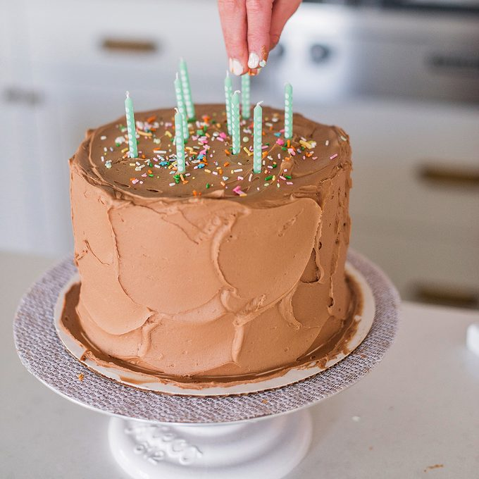 Birthday cake with candles and sprinkles.