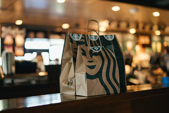 Starbucks bags on counter in store