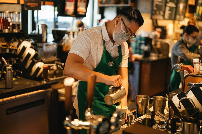 Starbucks employee wearing mask